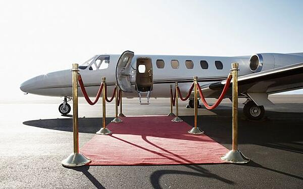 A private jet and red carpet to emphasise how words can make people feel special