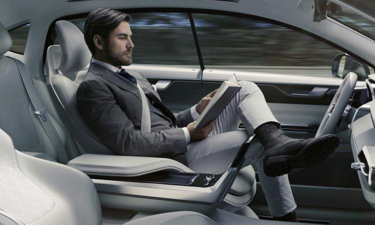 Man in self driving car to show that marketing automation lets sales teams concentrate on important tasks.